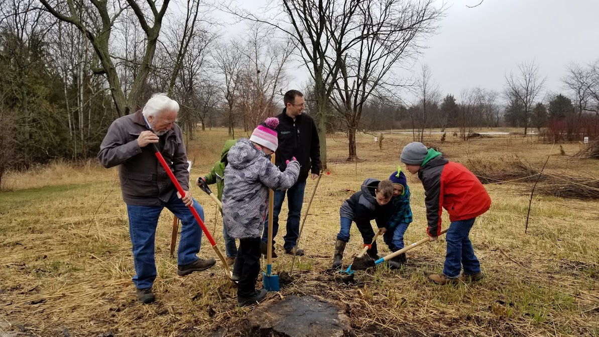 Engineer and students with shovels break ground for the Nature Explore Classroom