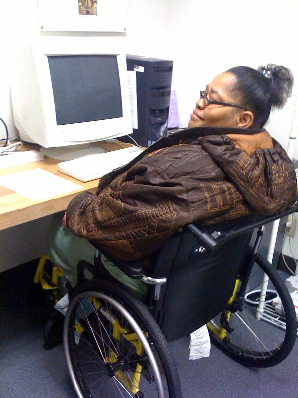 NHU computer recipient in wheelchair.
